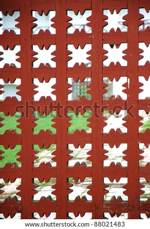 Red wooden grid background. Element of old wooden gate.