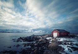 Red wooden house in beautiful nordic nature landscape, Lofoten Islands, Norway