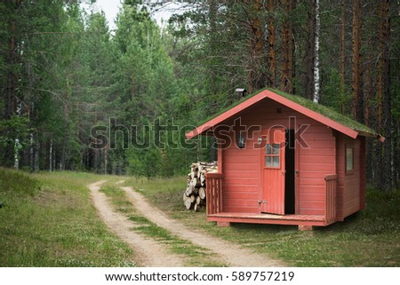 red wooden hunting lodge with...