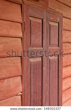 red wooden old wall and windows background in old house Lopburi province of Thailand