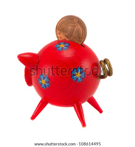 Red wooden piggybank isolated on white background. Saving money for black day in pig money-box. Nest-egg. Pfennig.