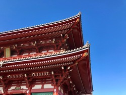 Red wooden roof of temple gate against blue sky. Beautiful of Japanese architecture building with wooden temple gate in Asakusa,Tokyo Japan.
