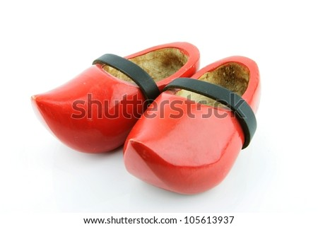Red wooden shoes / Dutch clogs with a black leather strap. Traditional Dutch footwear for farmers.