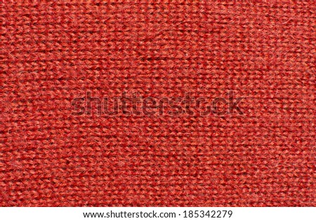 Red wool knit work. Red wool knit work full frame for warming backdrop or background.