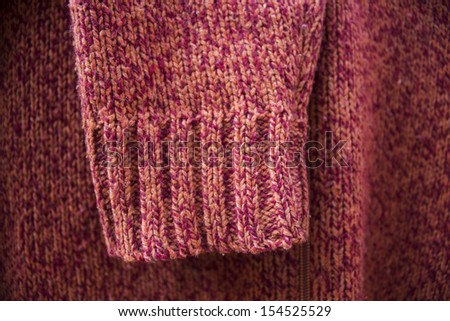 red wool Knitting sweater sleeve