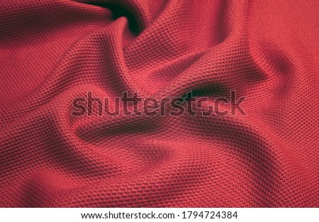 Red woolen fabric with waves. Crumpled fabric. Woolen shawl Stock photo ©