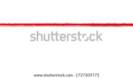 Red woolen thread stretched on a white background Stock photo ©