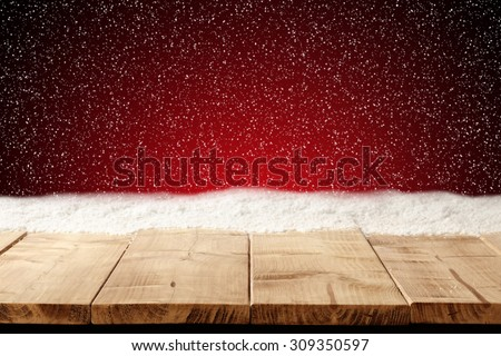 red xmas background space and table with snow