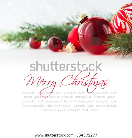 Red xmas ornaments and xmas tree on white background. Merry christmas card. Winter holidays. Xmas theme. Happy New Year. Space for text.
