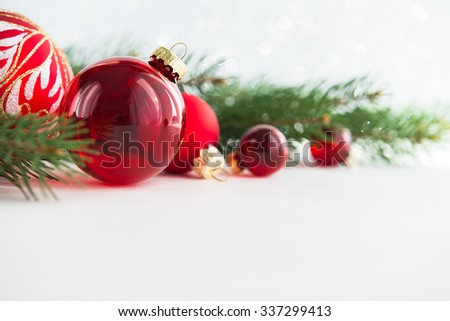 Red xmas ornaments and xmas tree on white wooden background. Merry christmas card. Winter holidays. Xmas theme. Happy New Year.