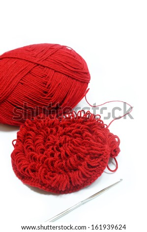 red yarn and crotchet hook isolated