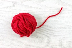 Red Yarn Ball Thread on White Background.