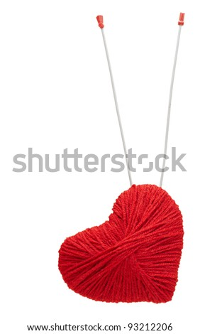 red yarn heart with spoke arrows, isolated on white