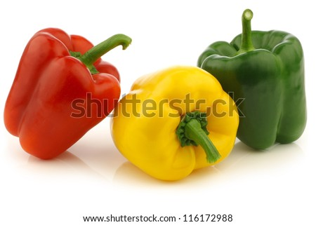 red,yellow and green bell peppers (capsicum) on a white background