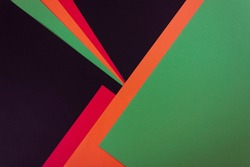 Red, yellow and green color paper on the black background. Black History Month concept. Flat lay. Copy space.