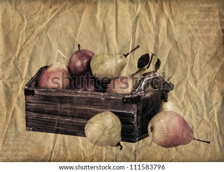 Red, yellow and green pears in a wooden crate. Antique effect brown paper background.