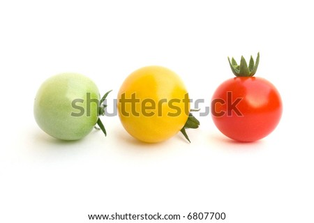 red, yellow and green tomatoes isolated on white background