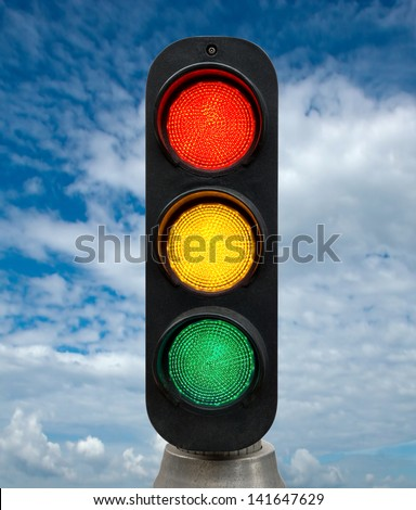 Red Yellow and Green traffic lights against blue sky backgrounds. Clipping Path included.