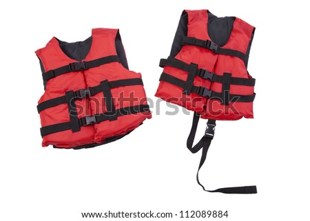 Red youth and child size life jackets isolated on white background