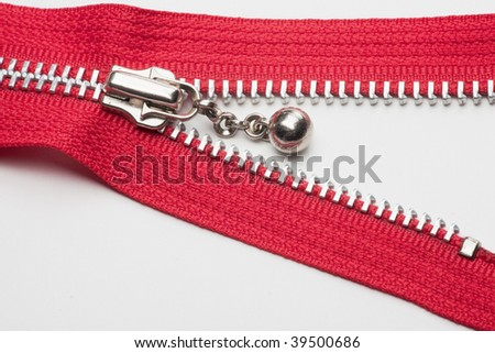Red zipper on white background
