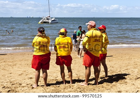 REDCLIFFE - APRIL 6: Beach lifesavers on duty during the annual Festival of Sails on April 6, 2012 in Redcliffe, Queensland. The Festival of Sails is held annually on Easter Friday.