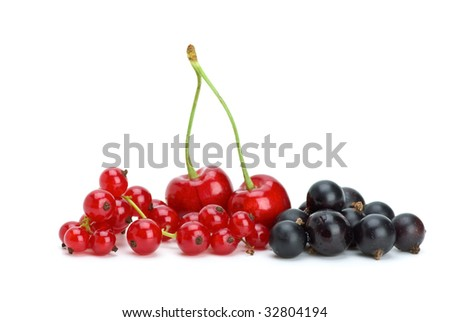 Redcurrants,blackcurrants and red cherries isolated on the white background