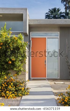 Reddish orange front door of a mid-century house #656371159
