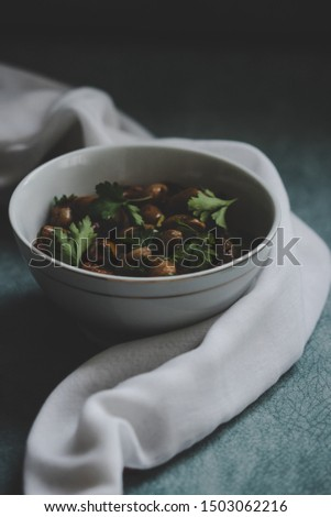 reddish shell bean salad with a white bowl