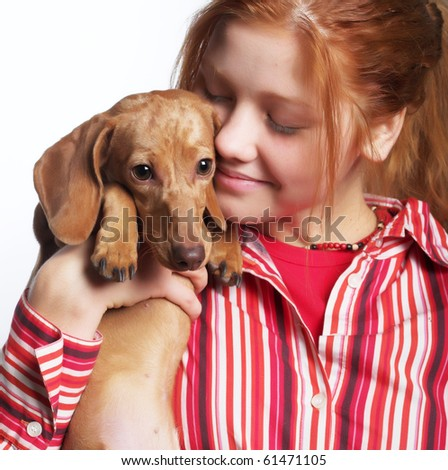 redhair girl  holding a dog