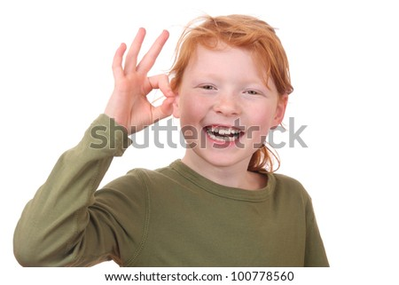Redhaired girl showing ok sign