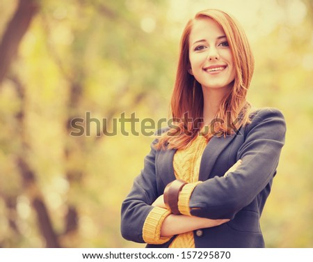 Redhead girl at autumn outdoor