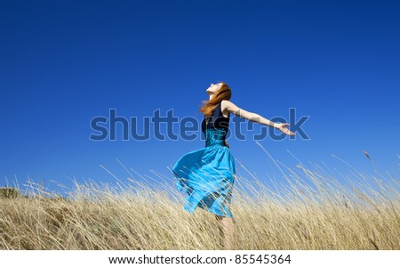 Redhead girl at windy field