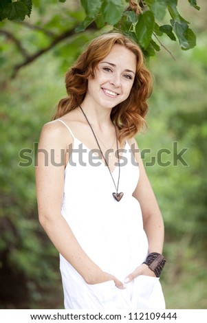 Redhead girl in the park.