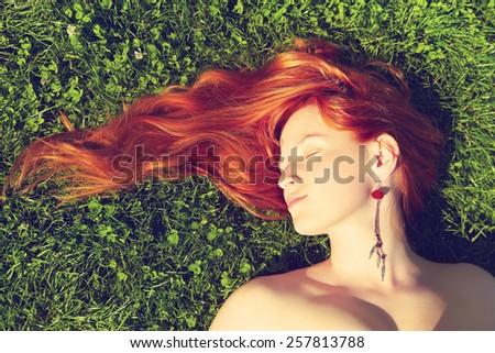 redhead girl relaxing lying on...