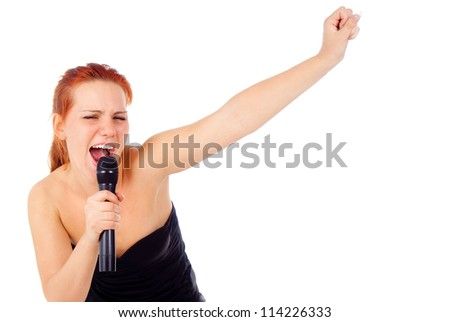 redhead girl sings into a microphone isolated on white background