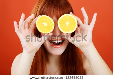 redhead girl with orange glasses - stock photo