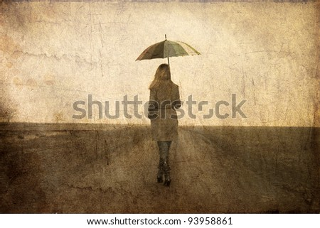 redhead girl with umbrella at...