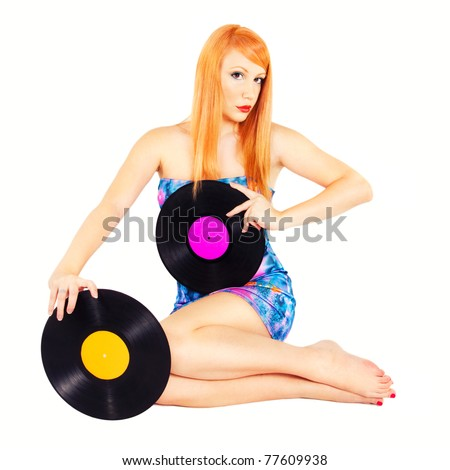 Redhead pinup holding records