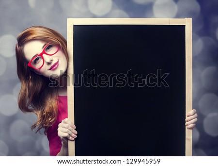 Redhead student with blackboard.