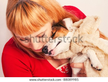Redhead with a jack russell terrier puppy - stock photo