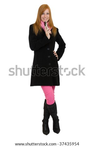 redhead woman standing with cell phone
