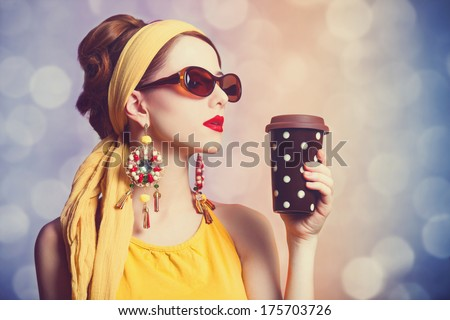 Redhead women with coffee. Photo with bokeh at background.