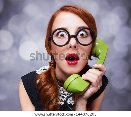 Redhead women with green telephone