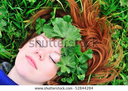 stock-photo-redheaded-girl-laying-on-the-green-grass-with-crown-from-leaves-52844284.jpg