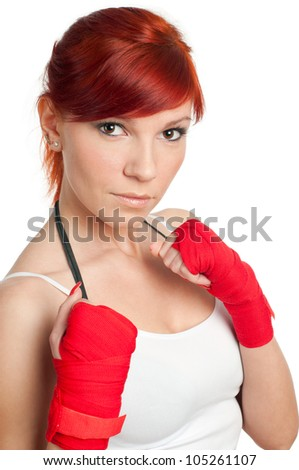 Redheaded young woman in boxing-bandage, isolated on white