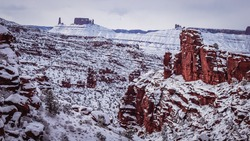 Redrock landscape shrouded in fresh snow after winter storm near Moab in Southern Utah