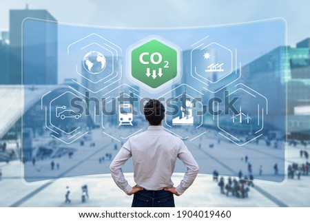 Reduce Carbon Dioxide Emissions to Limit Global Warming and Climate Change. Commitment to Paris Agreement to Lower CO2 levels with Sustainable Development as Renewable Energy and Electric Vehicles Foto d'archivio ©