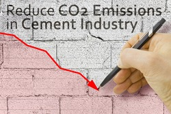 Reduce CO2 production in cement Industry and emissions in atmosphere - low-carbon cement production concept image with a descending graph