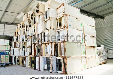 reduce, reuse, recycle of refrigerators in a recycling plant.