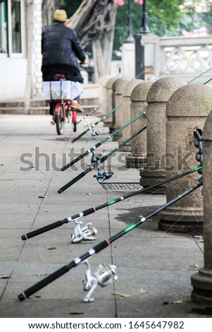 Reduce stress when fishing in the city river. Activity and free time in the city. Outdoor activity ストックフォト ©